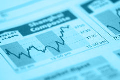 Stock Chart with pen. On newspaper Royalty Free Stock Photography