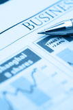Stock Chart with pen. On newspaper Royalty Free Stock Photos