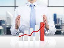 Stock chart on table. Businessman and stock chart on table, close up Royalty Free Stock Images