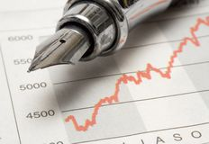 Stock Chart w/ Fountain Pen royalty free stock photos