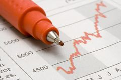 Stock Chart w/ Red Pencil Stock Photo