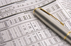 Stock charts with a gold and silver pen Stock Photos