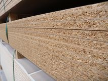Stock of chipboard boards in factory Royalty Free Stock Photo