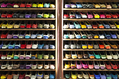 Stock colorful ballerinas shoes shelves store. A number of womens shoes stained with different colors. Shelving in a shop of womens shoes. Shoes are ballerinas Stock Photo