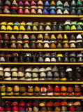 Stock colorful ballerinas shoes shelves store. A number of womens shoes stained with different colors. Shelving in a shop of womens shoes. Shoes are ballerinas Stock Image