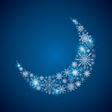 Stock crescent of a large set of snowflakes on a blue background Stock Image