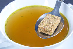 Stock cube with broth Stock Image