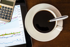 Stock Data Analysis with calculator and coffee cup Royalty Free Stock Photos