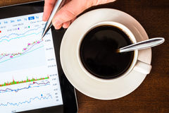Stock Data Analysis for coffee cup, mark the pen by hand Stock Photos