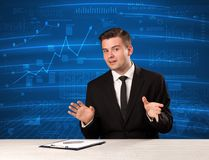 Stock data analyst in studio giving adivce on blue chart backgro. Und concept on background royalty free stock photos