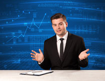 Stock data analyst in studio giving adivce on blue chart background. Concept on background stock photos