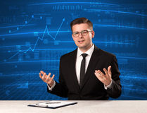 Stock data analyst in studio giving adivce on blue chart background. Concept on background royalty free stock photo