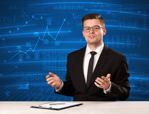 Stock data analyst in studio giving adivce on blue chart background. Concept on background royalty free stock photos