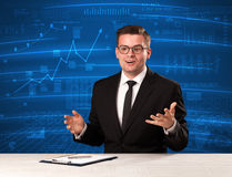 Stock data analyst in studio giving adivce on blue chart background. Concept on background stock photo