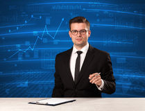 Stock data analyst in studio giving adivce on blue chart background royalty free stock photo