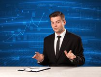 Stock data analyst in studio giving adivce on blue chart background. Concept on background royalty free stock image