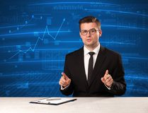 Stock data analyst in studio giving adivce on blue chart background. Concept on background stock image