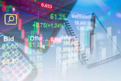 Stock data indicator analysis on financial market trade. Chart with calculator notebook and laptop background. Concept Stock data trade. Double exposure style Stock Photo