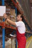 Stock di mantenimento dell'operaio Fotografia Stock