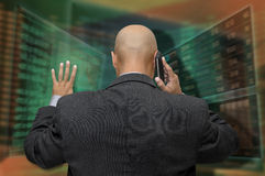 Stock exchange. Businessman or stock broker at the phone in stock exchange royalty free stock photos