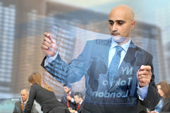 Stock exchange. Businessman with high tech stock exchange newspaper royalty free stock photo