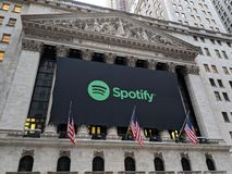 Stock Exchange. Banner on the New York Stock Exchange announcing the IPO of the streaming music service Spotify stock photography