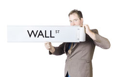 Stock exchange broker holding Wall Street sign Stock Photo