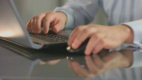 Stock exchange broker works on laptop, inserting data, scrolling. HD stock video