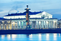 Stock exchange building and Rostral columns in St. Petersburg Royalty Free Stock Images