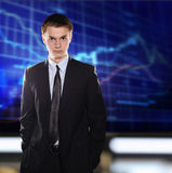 Stock Exchange businessman in a suit against a st. Ock quote stock image