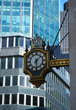 Stock Exchange clock. London. The clock positioned outside the Old Stock Exhange in London, surrounded by modern glass buildings Royalty Free Stock Photos