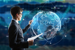 Stock exchange concept. Businessman drawing abstract digital globe on forex background. Stock exchange concept. 3D Rendering Royalty Free Stock Images