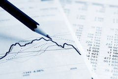 Stock exchange graphs analysis. Stock Photo