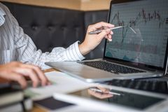 Stock exchange market concept, Business investor trading or stock brokers having a planning and analyzing with display screen and. Pointing on the data royalty free stock photography