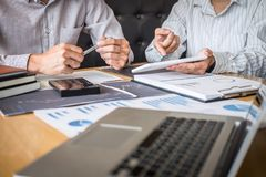 Stock exchange market concept, Team of investment trading or stock brokers having a consultation and analyzing with display screen. And pointing on the data royalty free stock photos