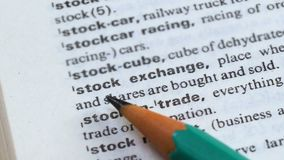 Stock exchange phrase in english dictionary, bonds selling and purchasing, trade. Stock footage stock video footage