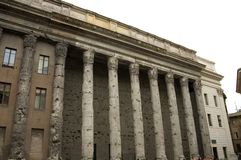 Stock Exchange, Rome, Italy. The magnificent remains of the Temple of Hadrian,in AD 145, stand among the 17th Century Piazza di Pietra or square now used as royalty free stock photo