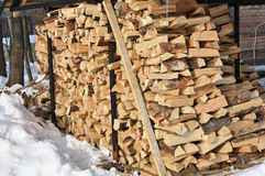 Stock of firewood. Warehouse of firewood in the winter rural yard Stock Photos