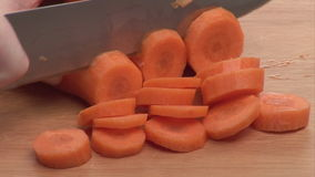 Stock Footage of Chopping Carrots stock footage