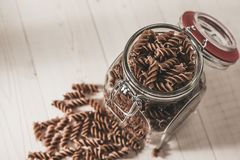 Stock fusilli pasta. In the kitchen - top view stock images