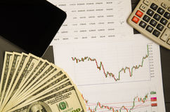 Stock graph and paper money for background .stock graph top vie Stock Photo