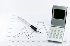 Stock graph report with calculator and pen Royalty Free Stock Image