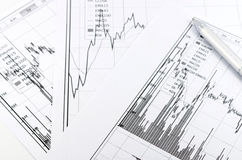 Stock graph report with pen Stock Photo