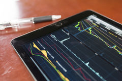 Stock graph with tablet Stock Photos