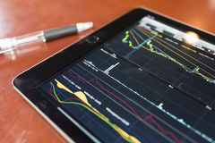 Stock graph with tablet Royalty Free Stock Image