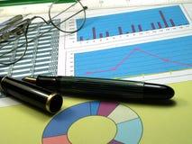 Stock graphs. Fountain pen over several stock graphs Stock Photography