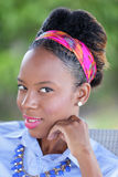 Stock head shot of a young Jamaican woman smiling Royalty Free Stock Images