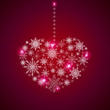 Stock heart of a large set of snowflakes on a red background.  Stock Images