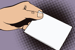 Stock illustration. Hands of people in the style of pop art and old comics. Blank sheet of paper for your message in the man' Stock Photos