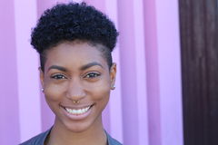 Stock image of an attractive young black woman with short haircut style.  royalty free stock image